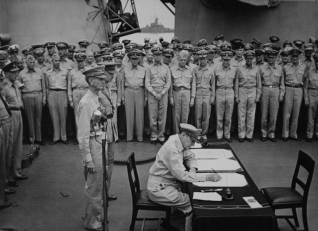 V-J Day on the USS Missouri :: Tokyo Bay - Surrender of Japanese aboard USS Missouri. Admiral Chester Nimitz, representing the United States, signs the instrument of surrender.