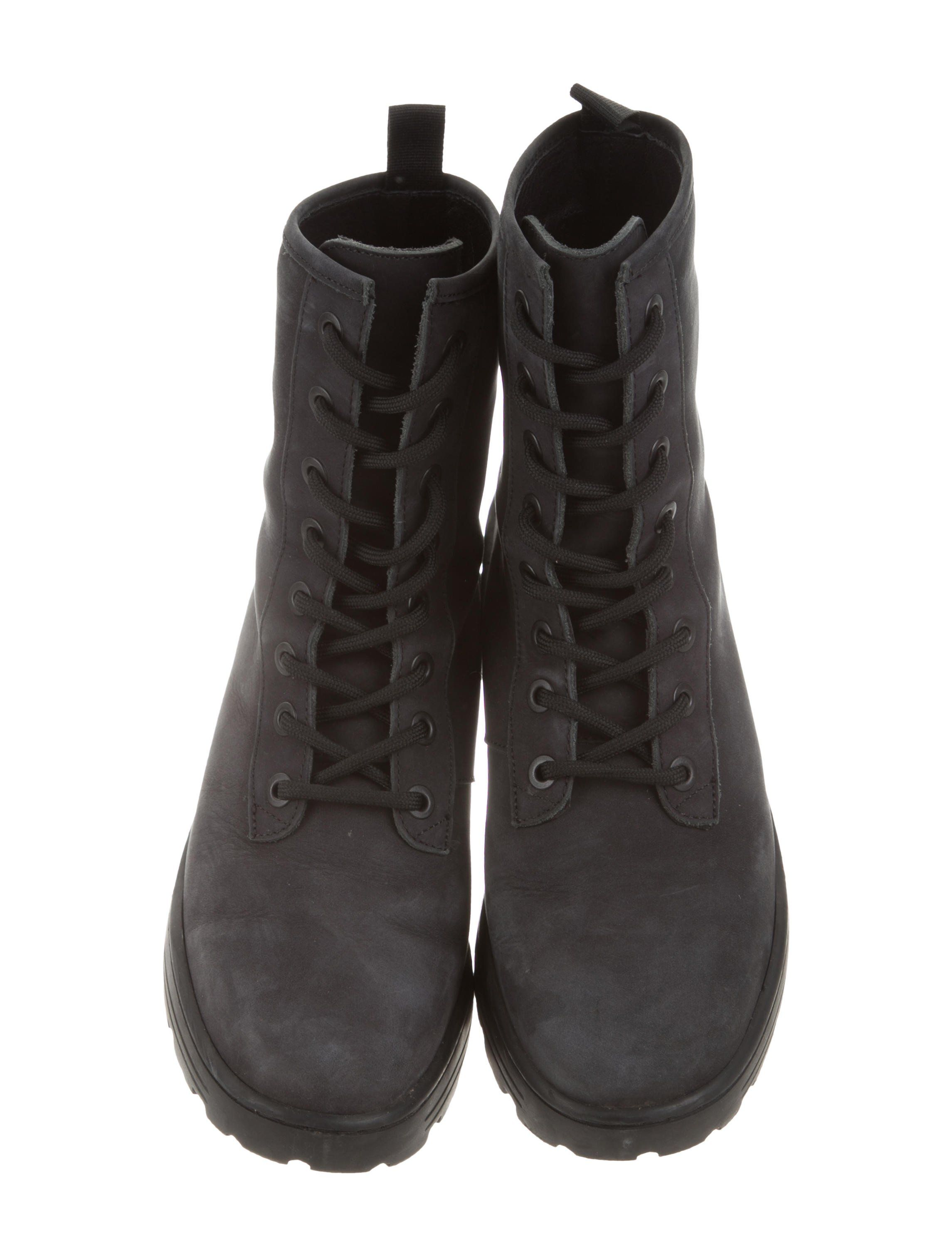 cbeee8b61980f From the Season 5 Collection. Men s graphite nubuck Yeezy round-toe  military boots with commando rubber soles and lace-tie closures at uppers.