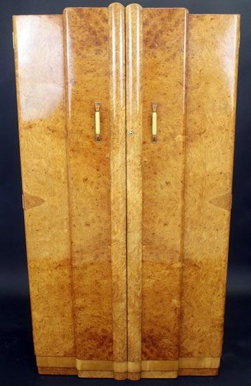 Art Déco armoire/wardrobe Harry & Lou Epstein. Original metal handles. Mahogany lined interior. England. Epstein furniture was originally founded in East London by Polish immigrants in the 1890s. The firm passed to brothers Harry and Lou Epstein and the pair turned their attention to the production of Art Deco forms from the 1930s until the 1950s. Art Deco style became the company`s trademark. Art Deco pieces are not signed.