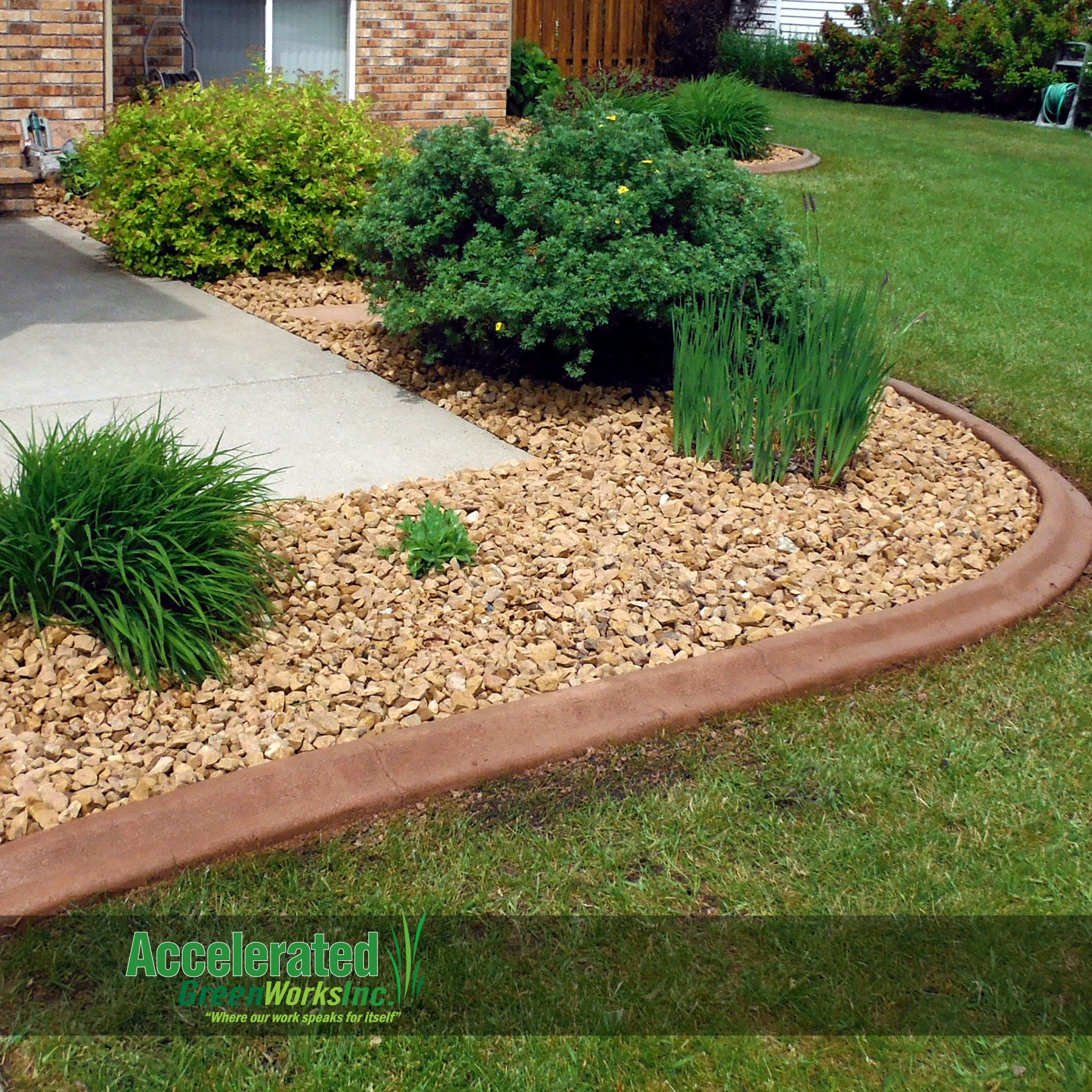 Colored Concrete Curb Edging Blends To Rock Bed While Providing A Nice Contrast With Lawn