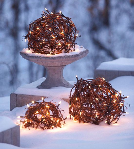 Globed Christmas Lights  Spheres of grapevines wrapped in lights become shimmering orbs on a coat of freshly fallen snow. Place these magical globes in birdbaths, urns, or on stairsteps to cast an ethereal glow on your outdoor landscape.