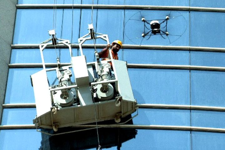 Drone Helps Save Window Cleaner Stuck On High Rise Scaffolding By
