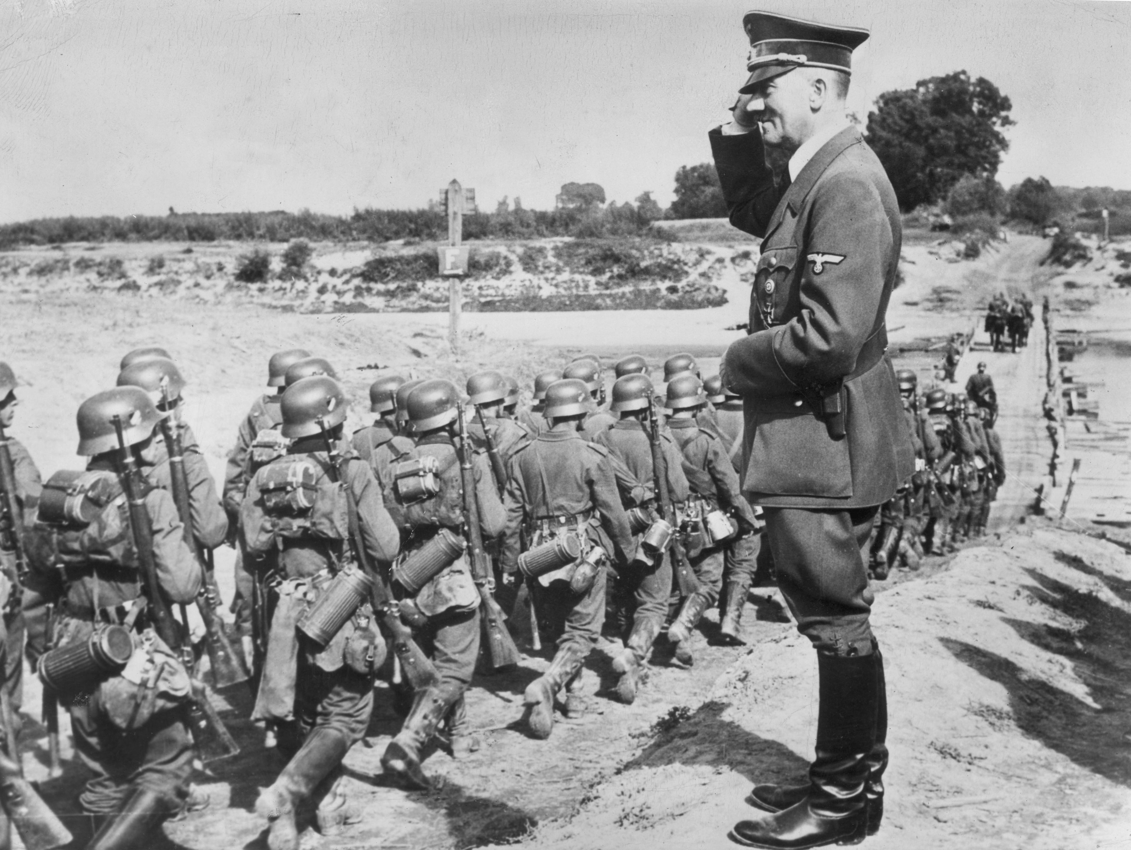 Adolf Hitler salutes his troops invading Poland, Sept 1939. This ...
