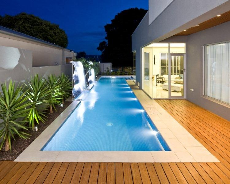 pool ideas - decking flush to coping, garden bed adjacent to fence