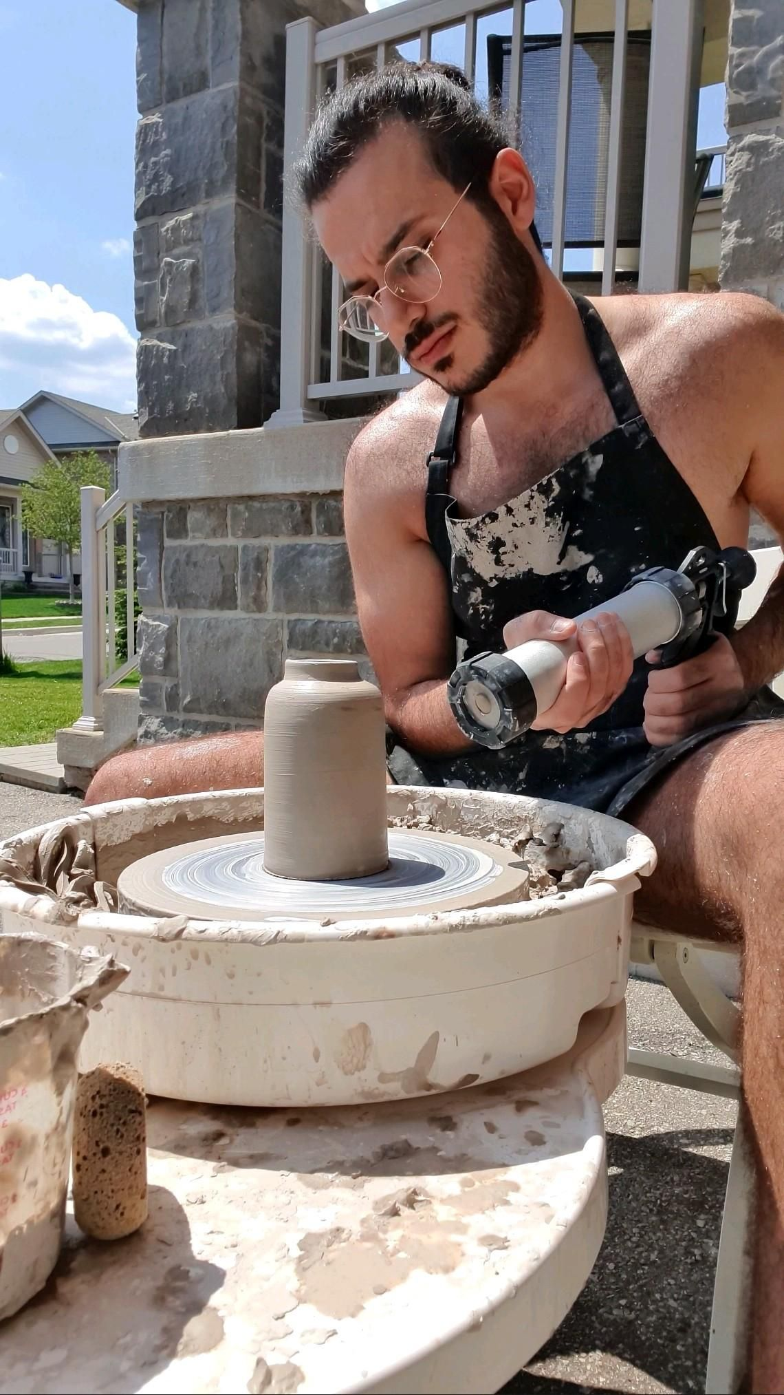 Making a pottery vase with a handle and a ring