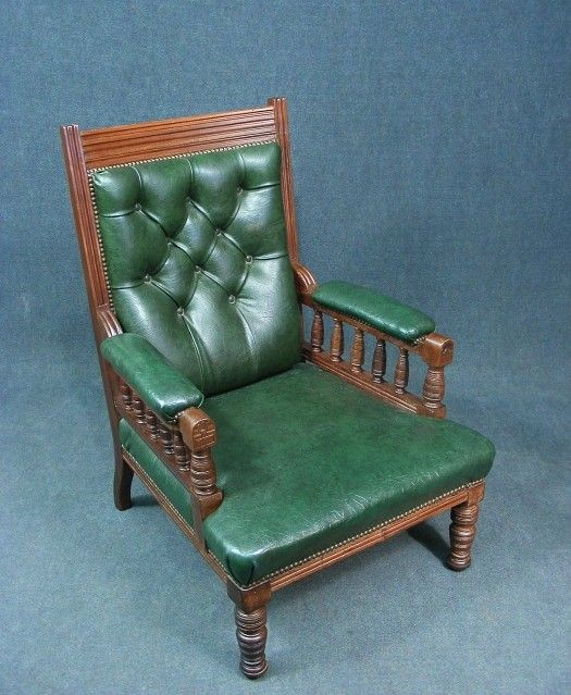 a fabulous antique button back library armchair superb green upholstery large spacious seat padded arm rests and button back all with stud detail solid