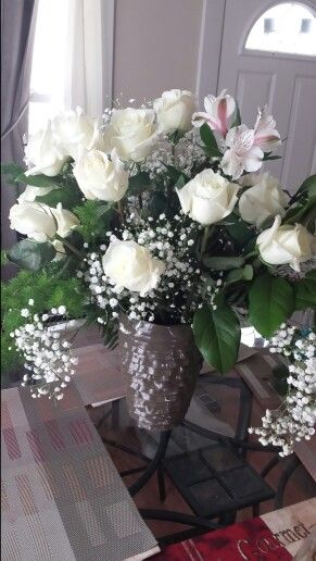 """A perfect dozen roses shout """" Be mine"""" White roses are a symbol for true love. A traditional wedding flower. Design by Jaime Tablas"""