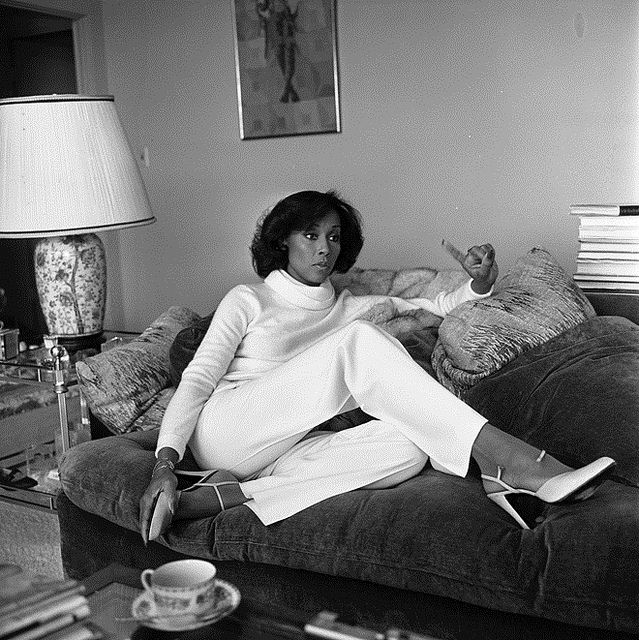 "Dominique Deveraux aka Diahann Carroll | 1979  Actress Diahann Carroll holding court in her living room discussing the plight of Blacks in the television industry. Quote, ""For some reason, whenever black skin is on television, everyone relates to it as if it's a documentary.""'"