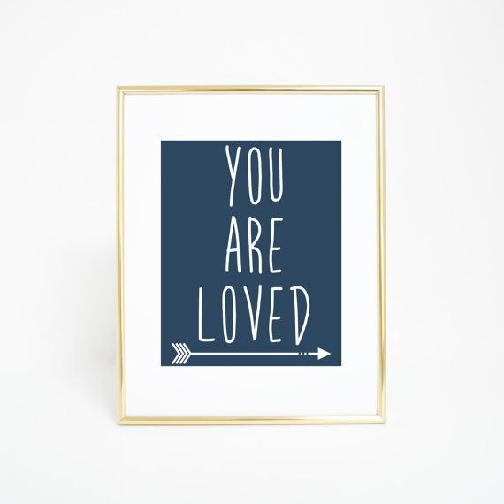 Bring the good vibes into your home with this navy blue and white you are loved typography wall art print. It's a great addition for any home, dorm, office or nursery.