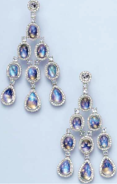 A PAIR OF MOONSTONE AND DIAMOND EAR PENDANTS  Each rose-cut diamond, within a circular-cut diamond surround, suspending a series of cabochon moonstone links, each with circular-cut diamond borders, spaced by rose-cut diamond links, mounted in 18k white gold The total weight of the moonstones and diamonds is approximately 43.10 and 5.00 carats respectively