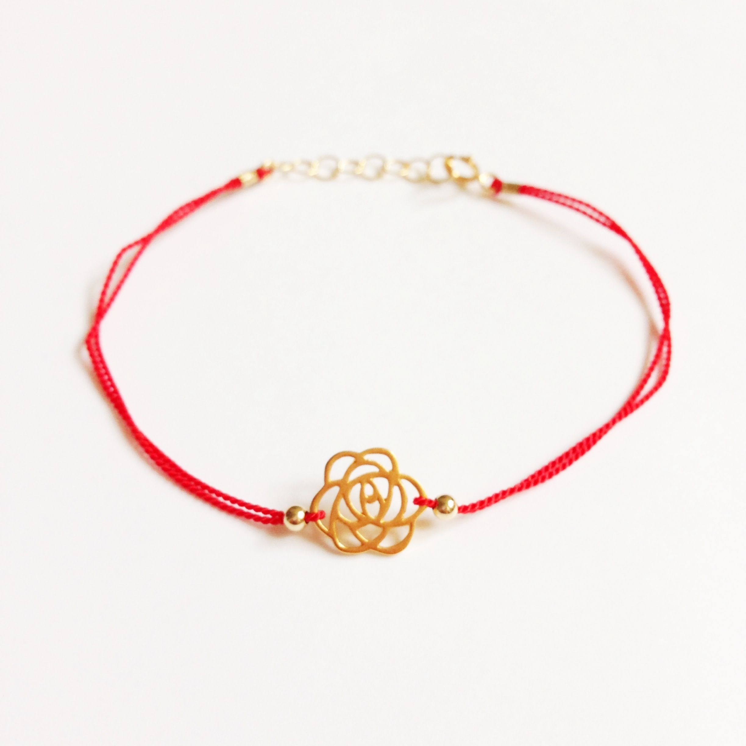 Gold fill rose charm strung on a strong nylon thread symbolizing