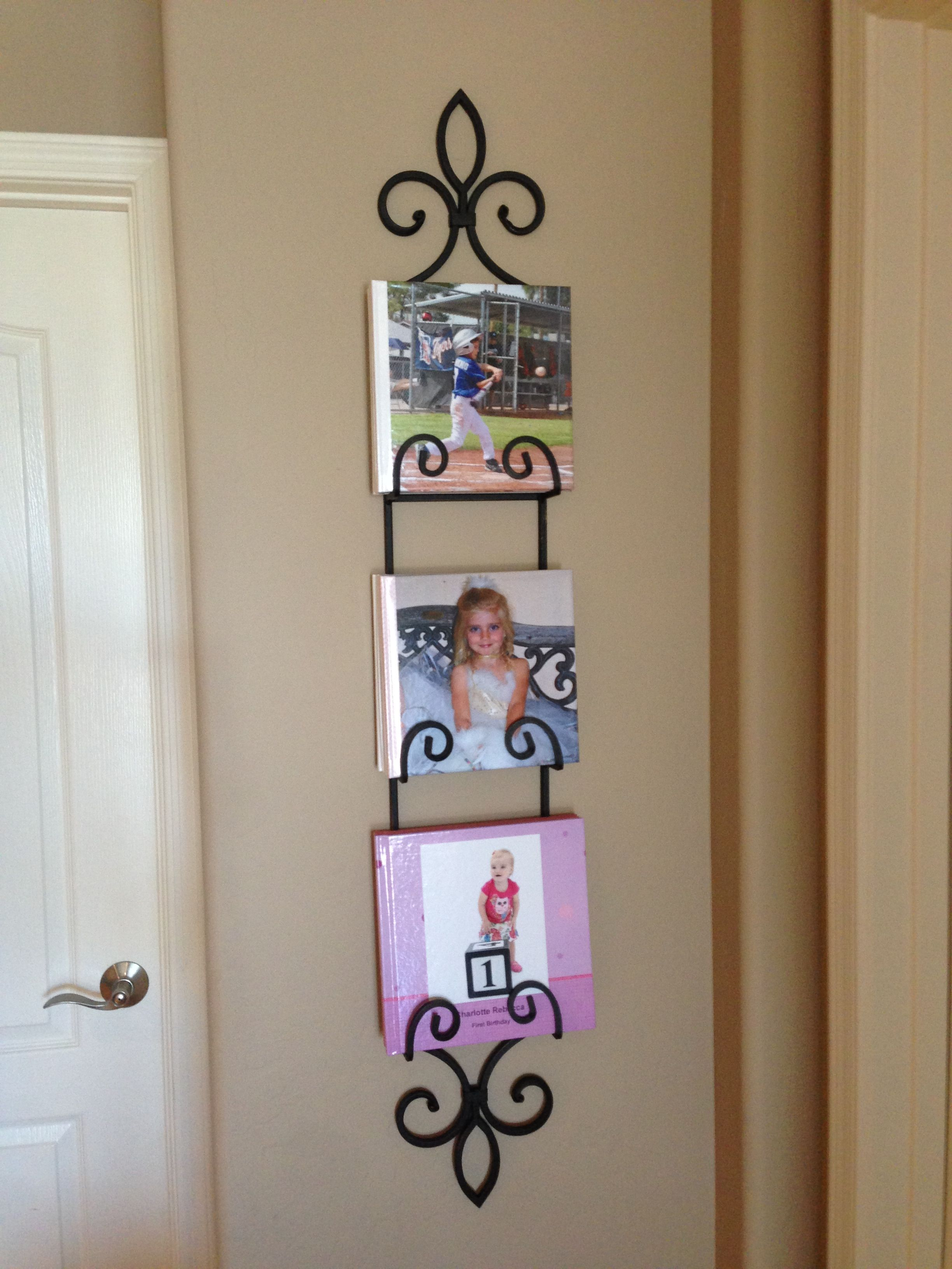 Use a plate display hanger for scrapbooks or picture books. It's an easy opportunity for family, friends and guests to look at them plus now they won't be hiding in bookshelves.