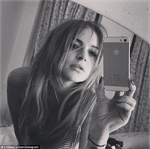 http://news-all-the-time.com/2014/04/29/lindsay-lohan-shares-two-tired-selfies-after-returning-home-from-europe/ - Lindsay Lohan shares two 'tired' selfies after returning home from Europe  - By Cassie Carpenter  She just returned from Europe where she attempted to find financing for her film Inconceivable. And Lindsay Lohan shared a bleary-eyed, bw selfie after landing in her native New York Tuesday. 'Tired* but home sweet home i ❤ nyc,' she wrote to her 1.2 mi
