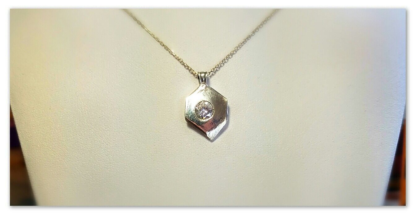 100% Pure Silver pendant and Sterling bale holding a brilliantly shining 2.84ct Clear Cubic Zirconia gem. Hand made with love by me!