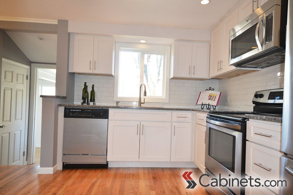 Light Clean And Classic White Shaker Cabinets In An L Shaped
