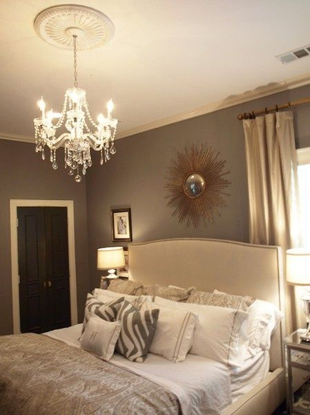 lovely bedroom, starburst mirror, contrast closet doors. white