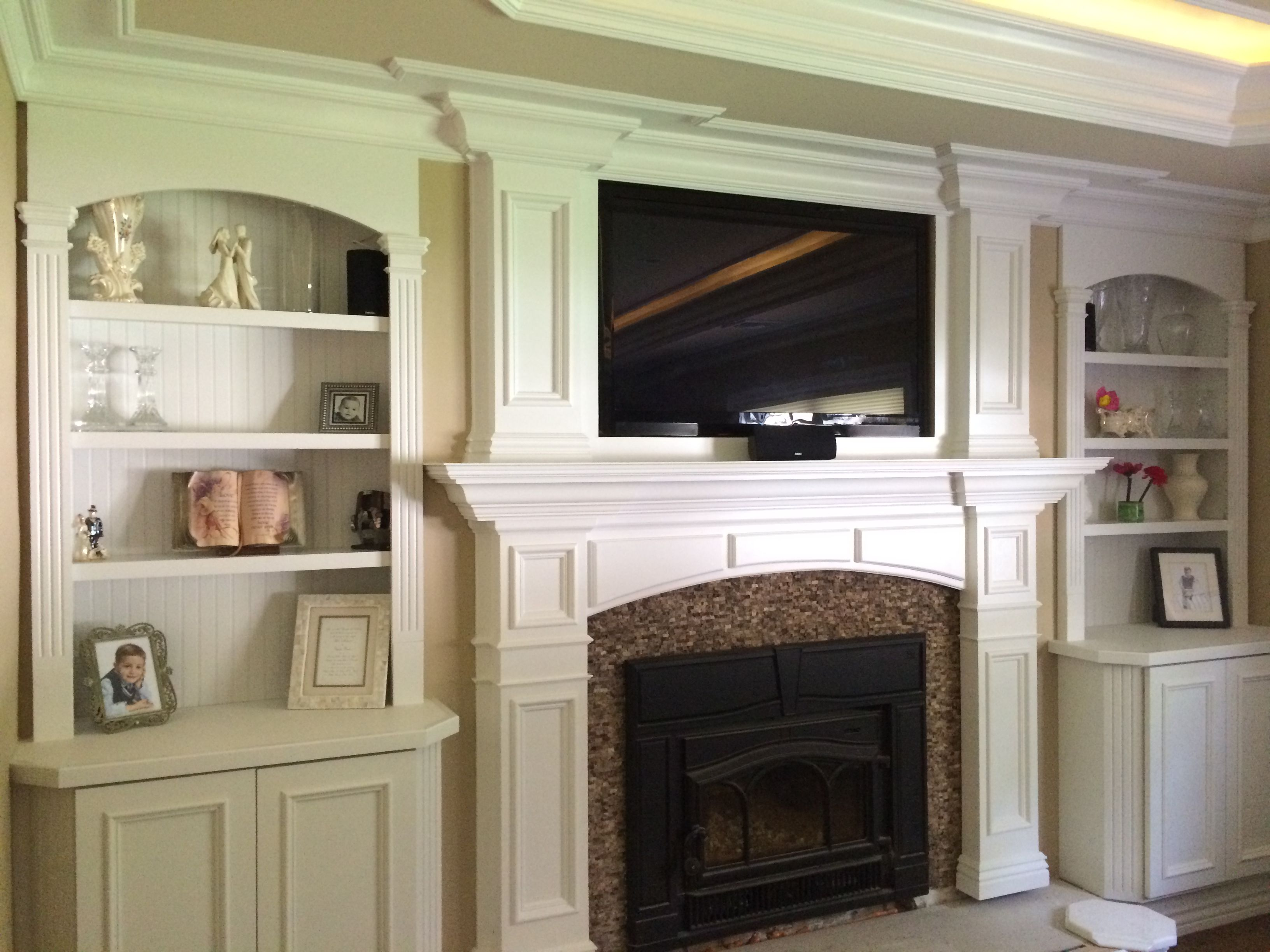 Custom mantel tray ceiling home theater moldings Built ins