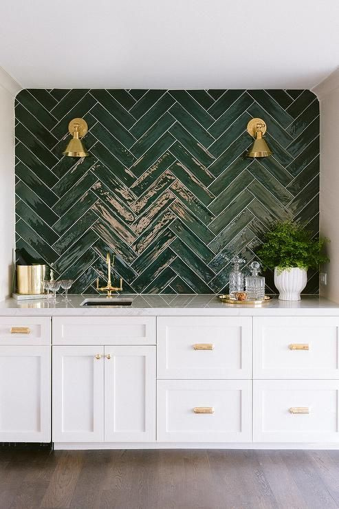White Wet Bar with Green Tiles and Brass Lights -