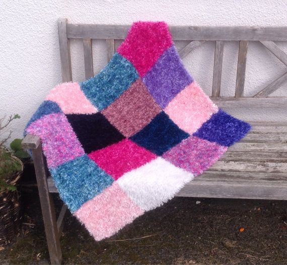 This gorgeously soft and fluffy blanket was knitted using a