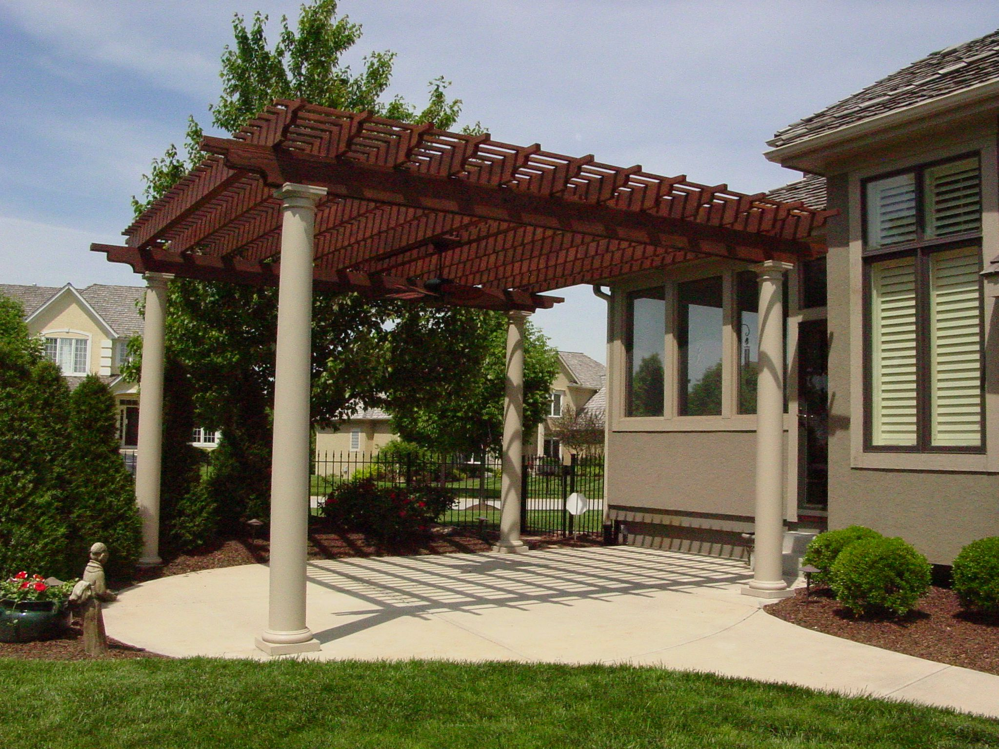 Freestanding stained/ painted cedar pergola with fiberglass columns; built  by DW Elite Decks in