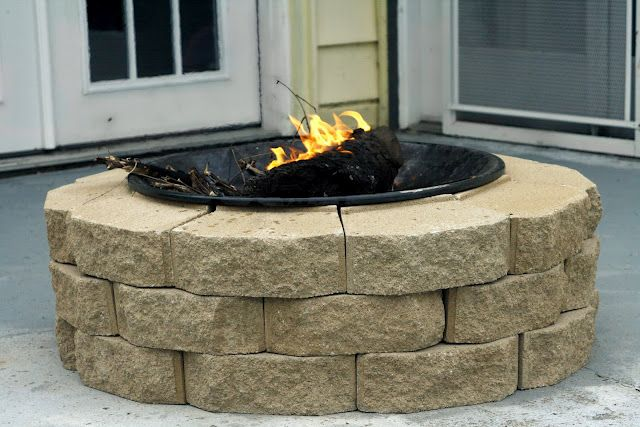 "DIY Fire Pit: I'm repinning this again because we just bought similar bricks at home depot to make our own firepit! Ours will be slightly bigger, as we got the 12"" stones instead of the 8"" pictured here. And since we got the bigger stones, ours cost $45, instead of the $30 this blogger paid, but I think it's worth it for the bigger fire pit!"