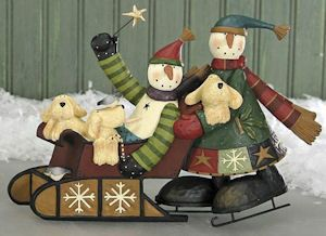 """Williraye Snowmen Sledding & Dogs.  Free Ground Shipping.  Made of Resin, Metal.  Hand Painted.  Approximately 5"""" Tall x 8"""" Wide.  Gift Boxed.    $45.99.  http://www.happyholidayware.com/Christmas-Indoor-Decorations-Stockings.htm"""