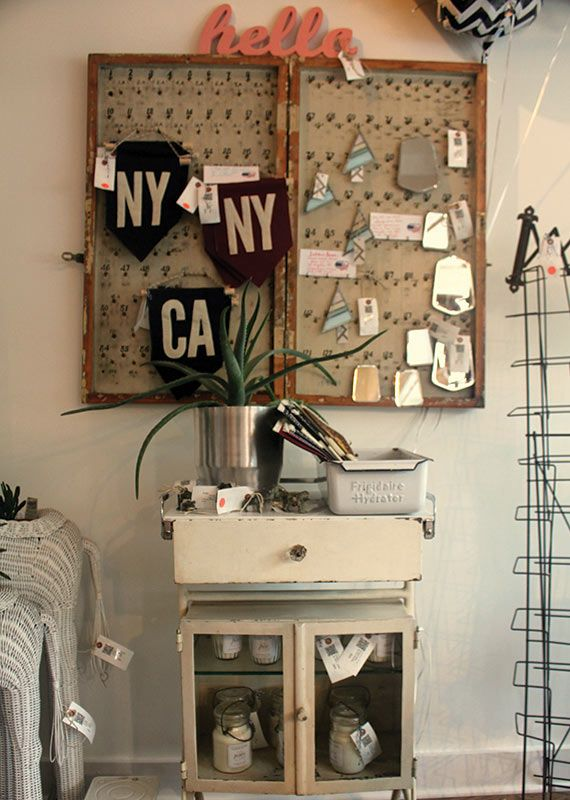 Felt flags that represent New York and California; custom made pillows created from leftover rug pieces; and various goods at Katonah New York's Old New Home.