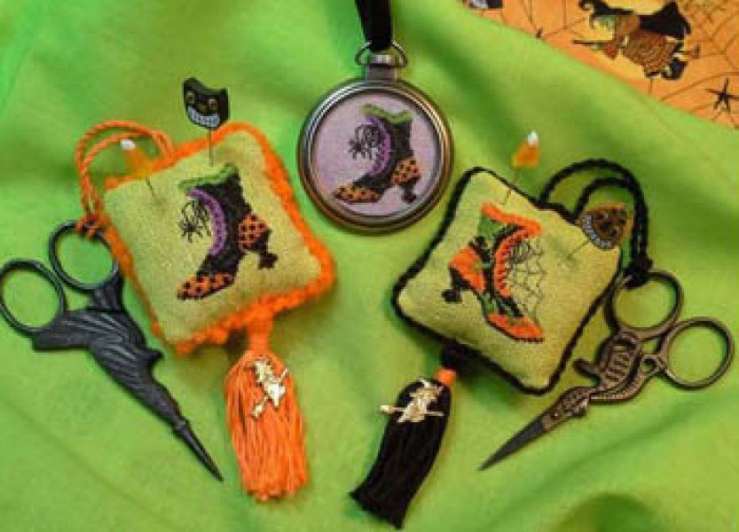 Imelda's Closet is the title of this fun Halloween cross stitch pattern from Blackberry Lane. Here is link if you wish to order the pocket watch frame as shown in the photo.