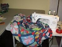great info on how to quilt large quilts on a domestic machine/tons of other quilting info