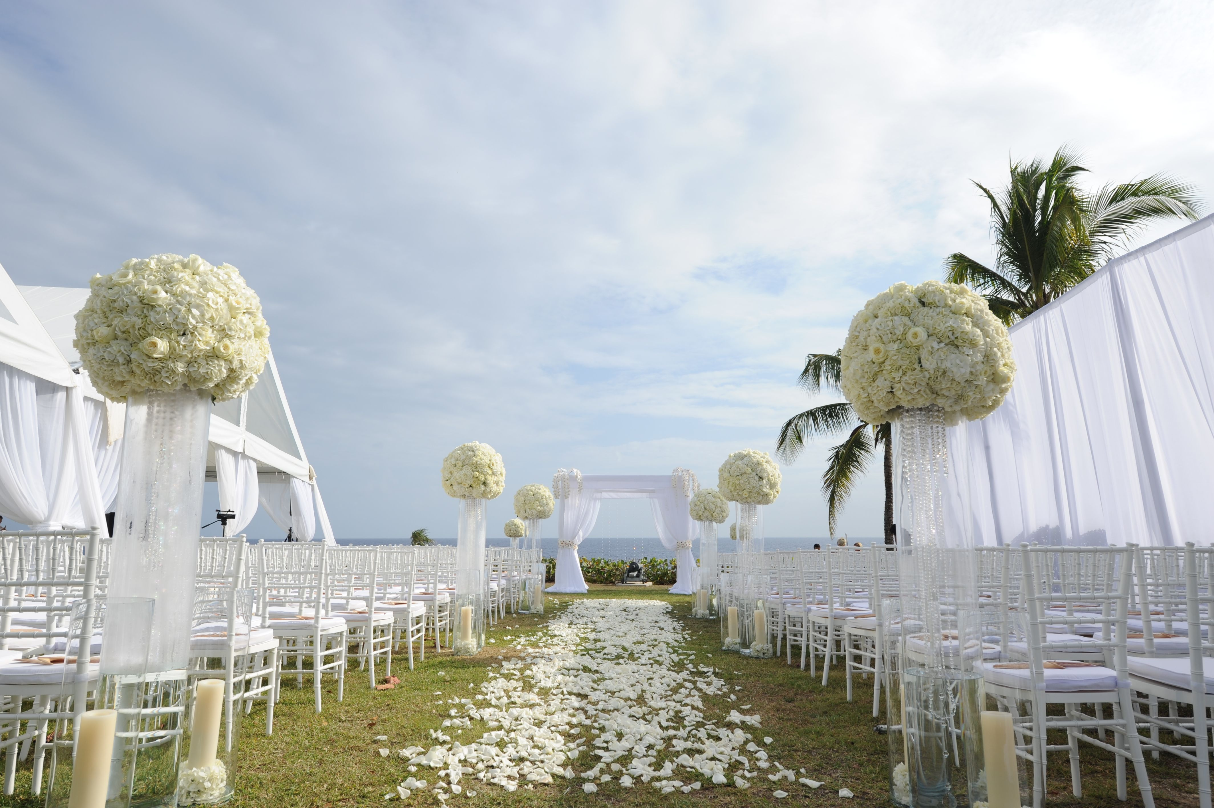 Wedding Ceremony Arch And White Rose Petal Aisle In Grand