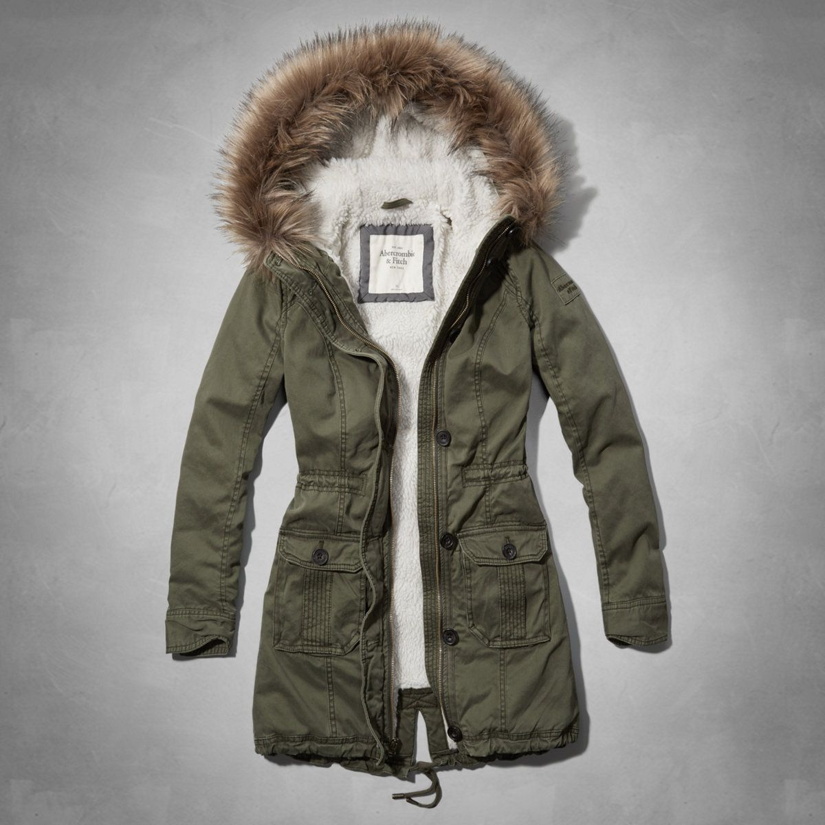 Supersoft Longer Length Parka With Cozy Sherpa Lining Faux Fur Bettina Heels Netty Beige Trimmed Hood Front Pockets Drawcord At Waist Full Zipper Closure Heritage Logo