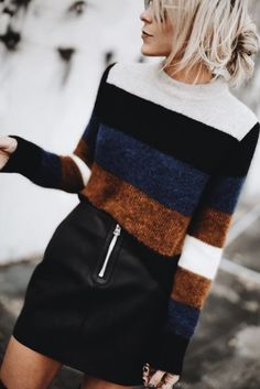 the perfect fall outfit with a sweater and leather skirt.