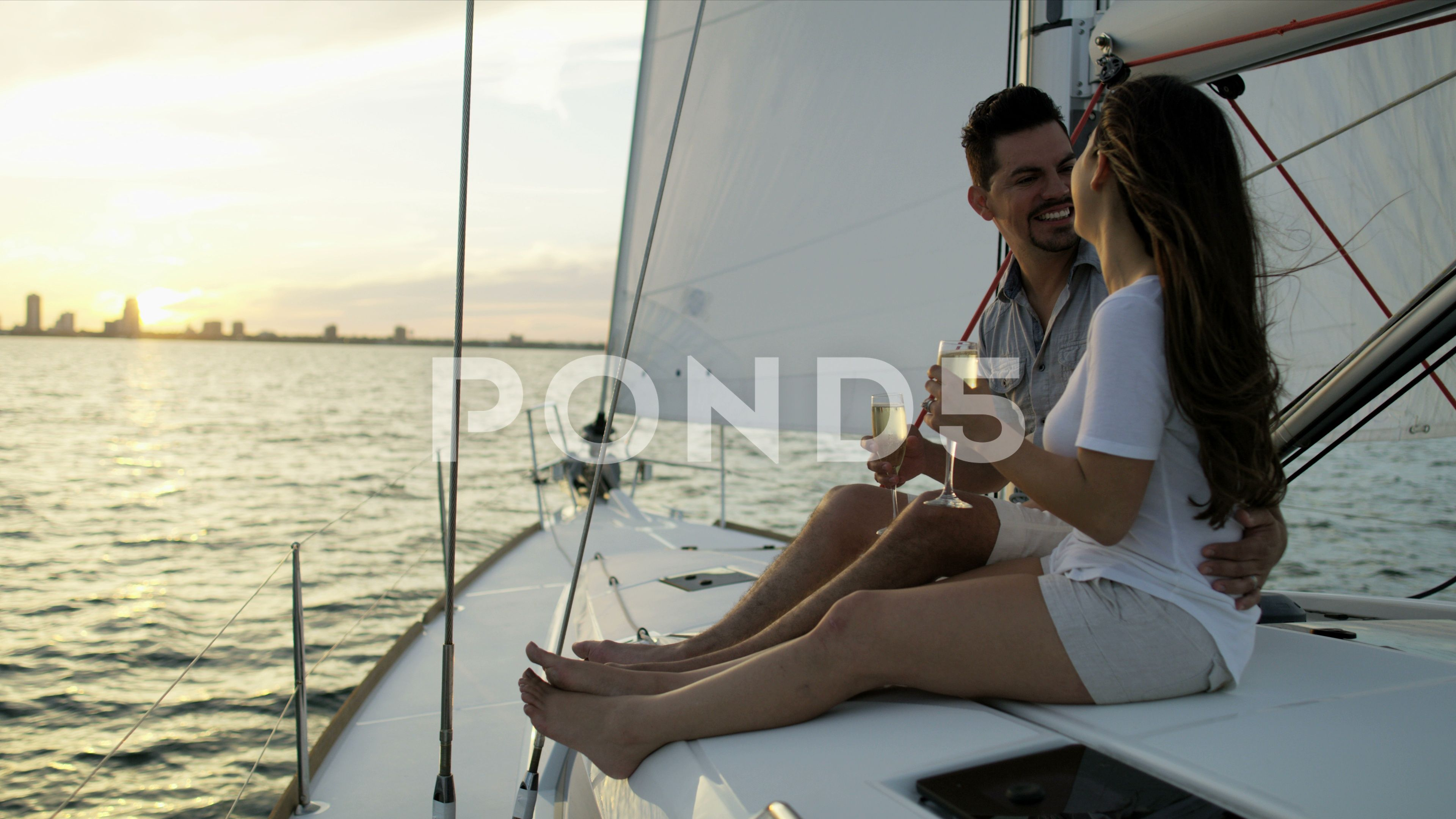 Carefree Latin American Couple At Leisure Sailing The Ocean On