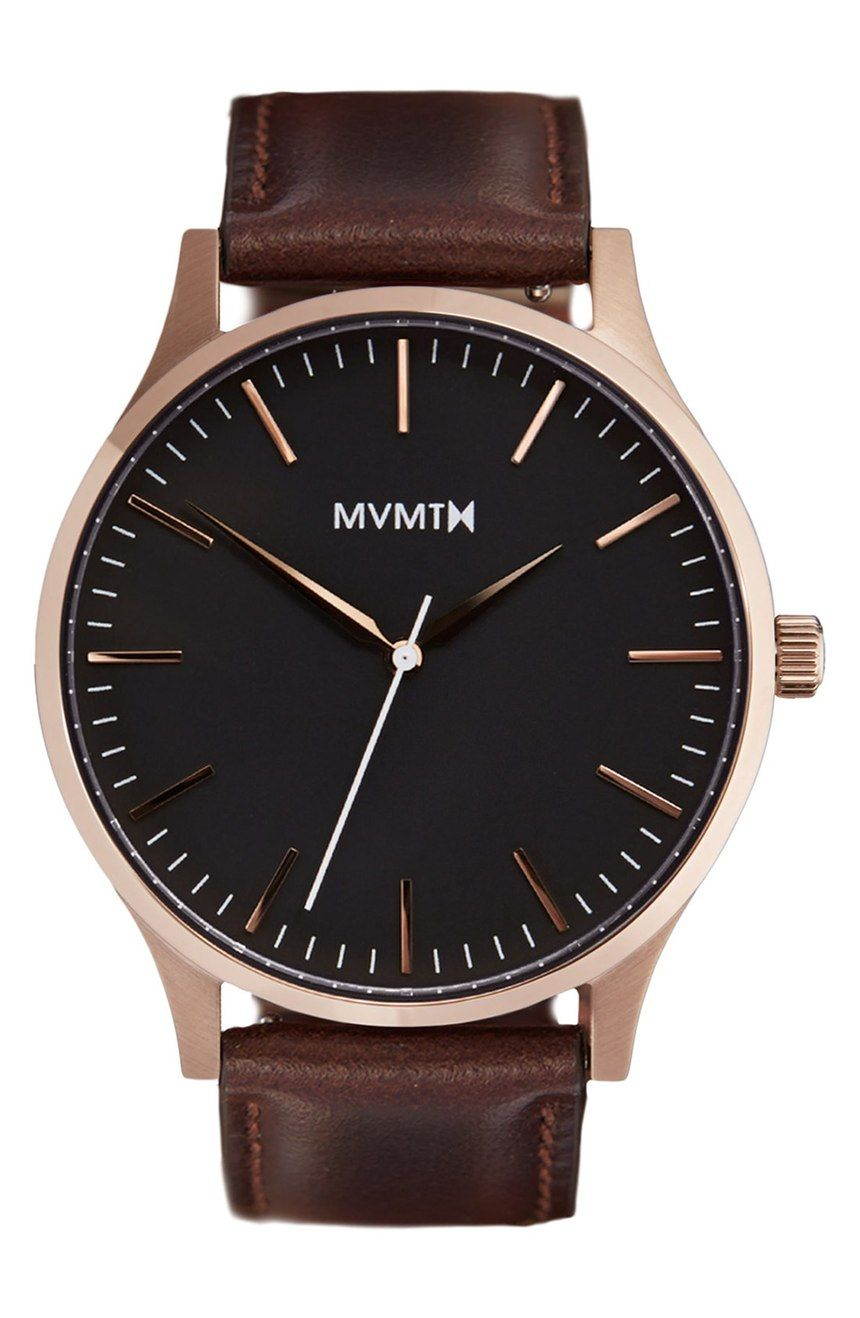 Really liking this cool and trendy watch with a rich leather band and rose gold details.