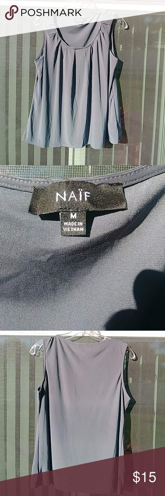 Women's Naif Top Top is in very good condition.  Sleeveless and dark gray in color. Naif Tops