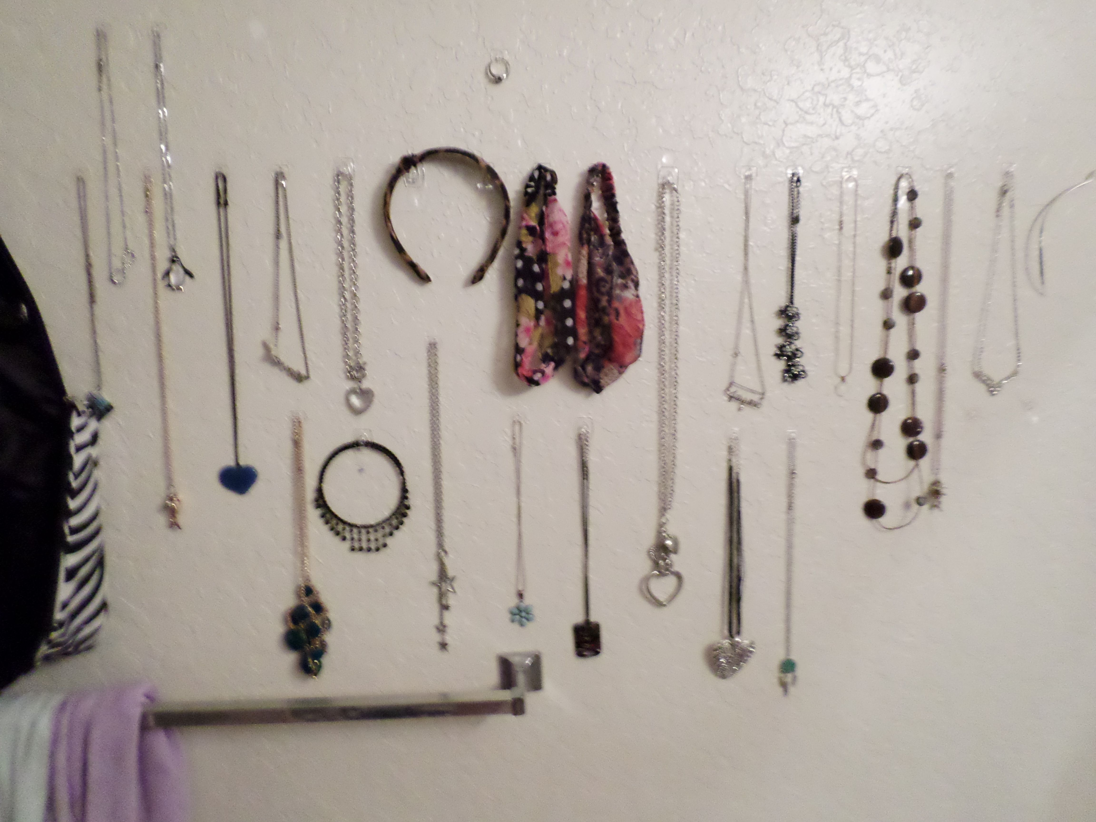 Hanging all the necklaces and headbands I own on the command hooks you can get at the store. Saves tons of space and makes my jewelry easy to throw on since I don't have to search for it. It also makes my walls seem less bare and boring!