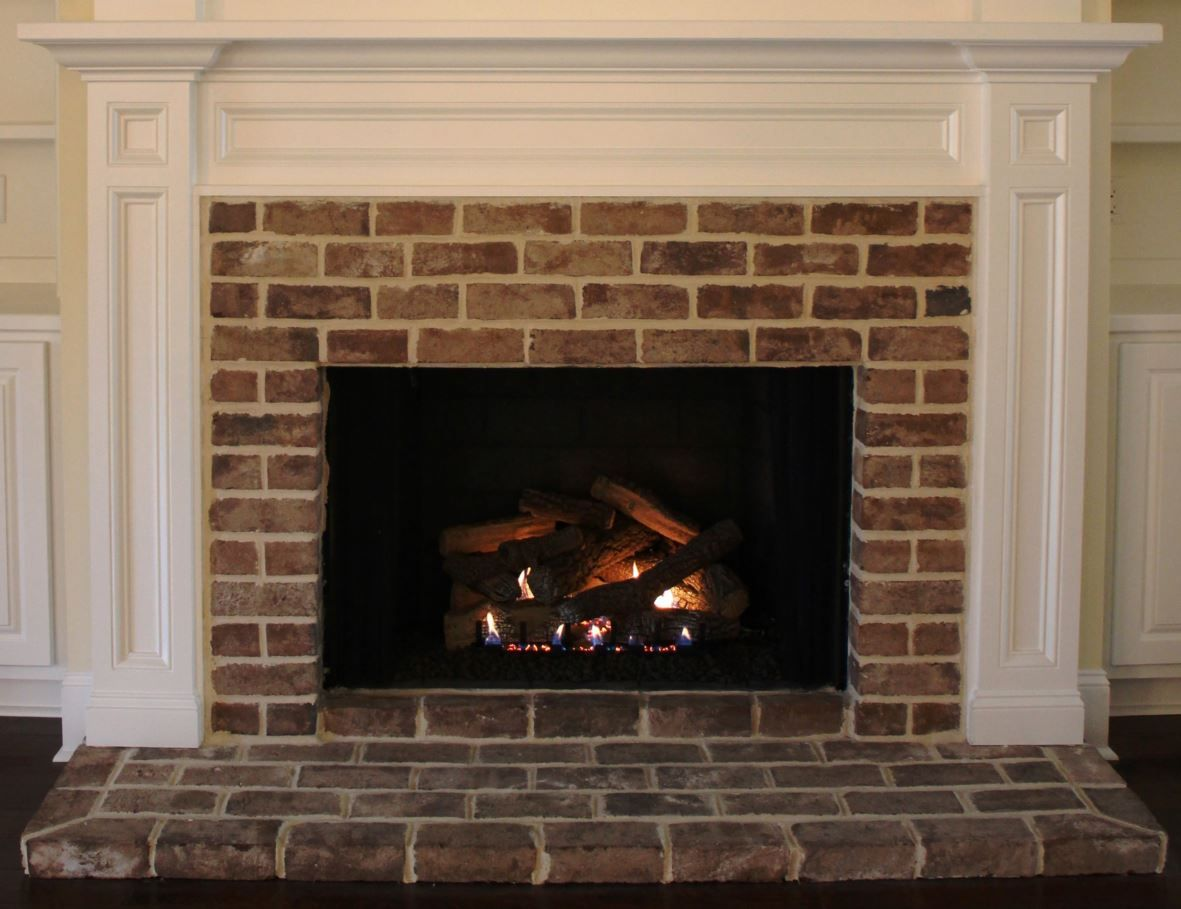 F Savannah Mantel Shown With Brick Surround And Low Hearth