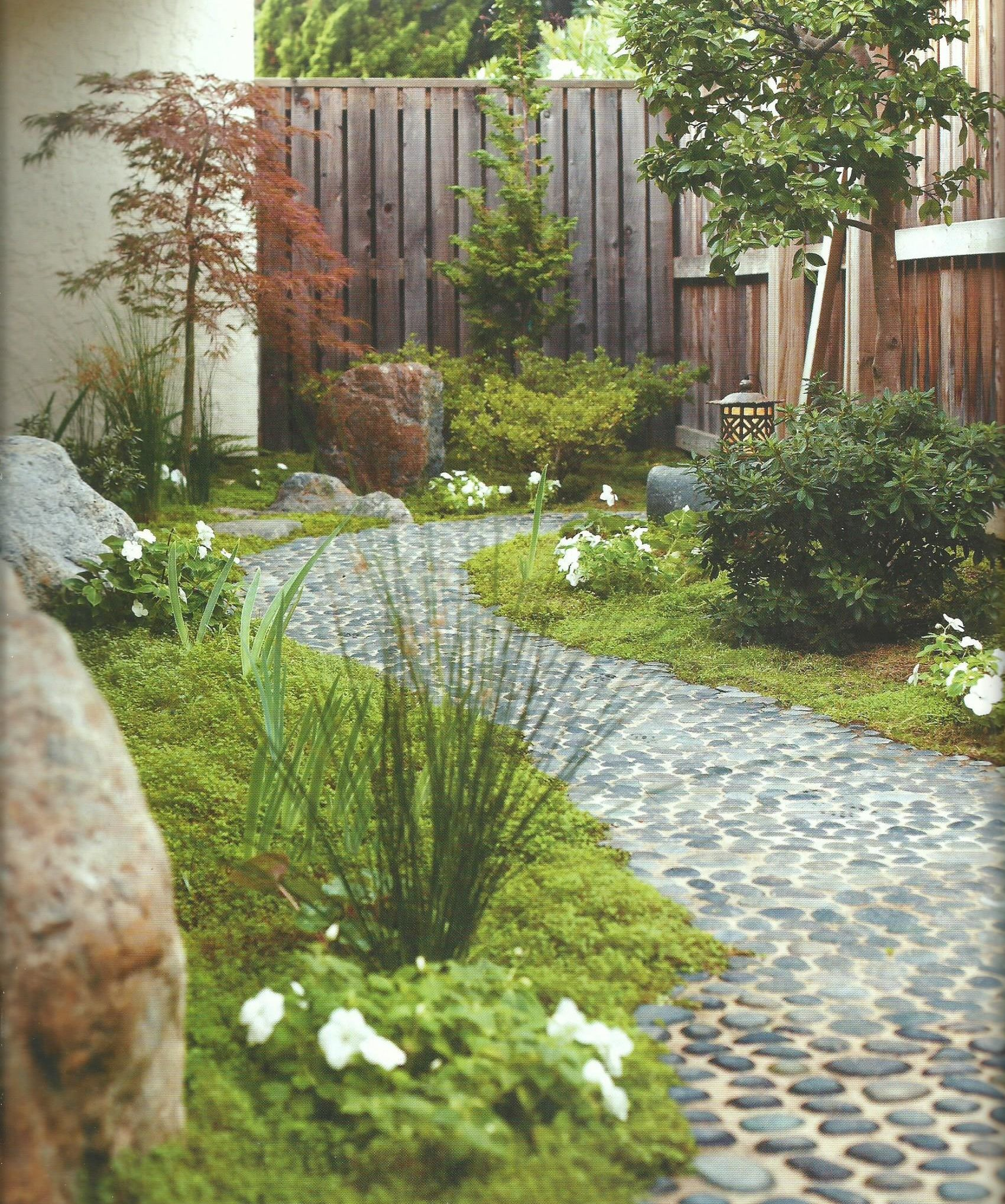 Garden Path Made Of Smooth, Flat River Rocks Set In