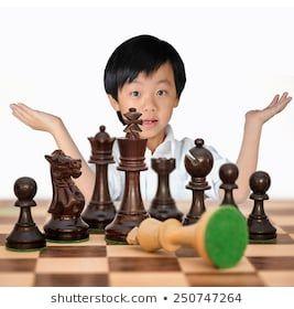 Young Asian boy winning chess game