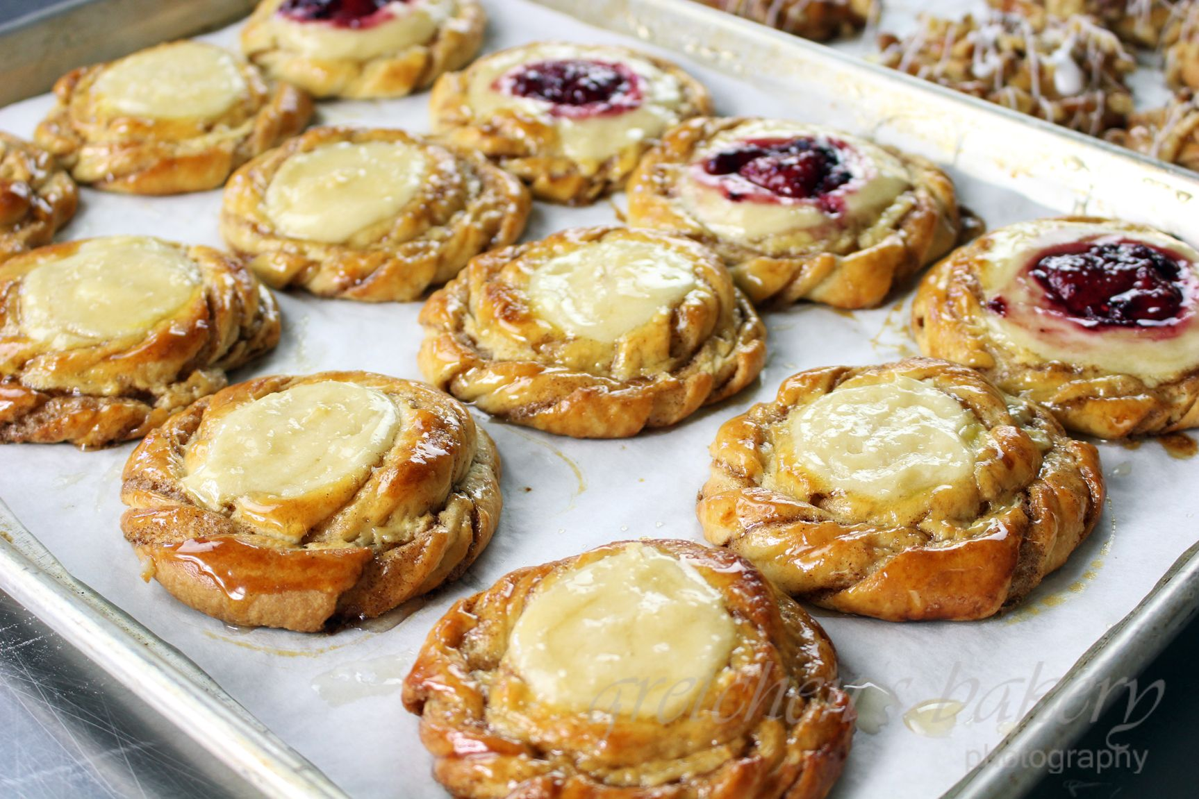 Easy mock danish style dough formed into fruit and cheese danish snails just like the professional bakeries! Fill them with anything you like!