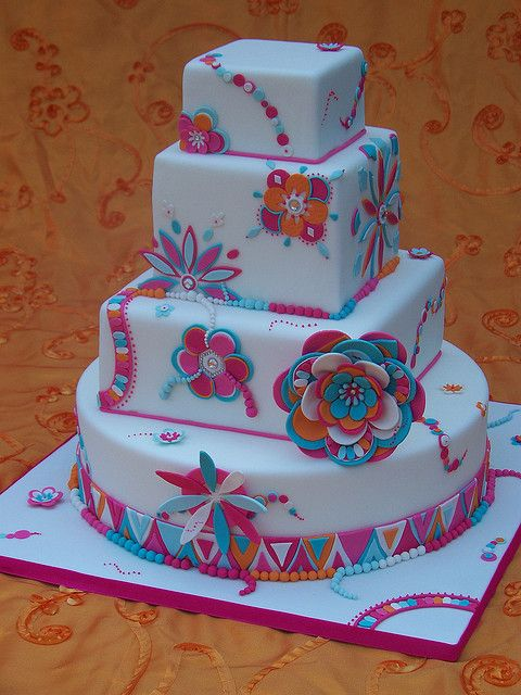 The original design was created by my cake idol, Ron Ben Israel.  His extraordinary cake was in black, white, and greys.
