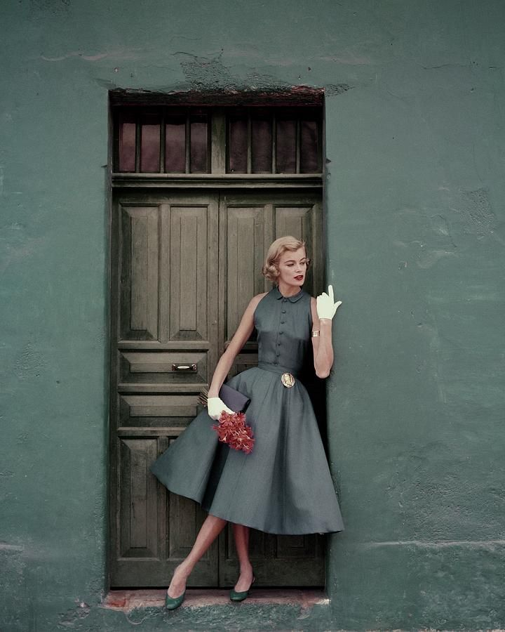 A 1950s Model Standing In A Doorway by Leombruno-Bodi #vintagefashion1950s