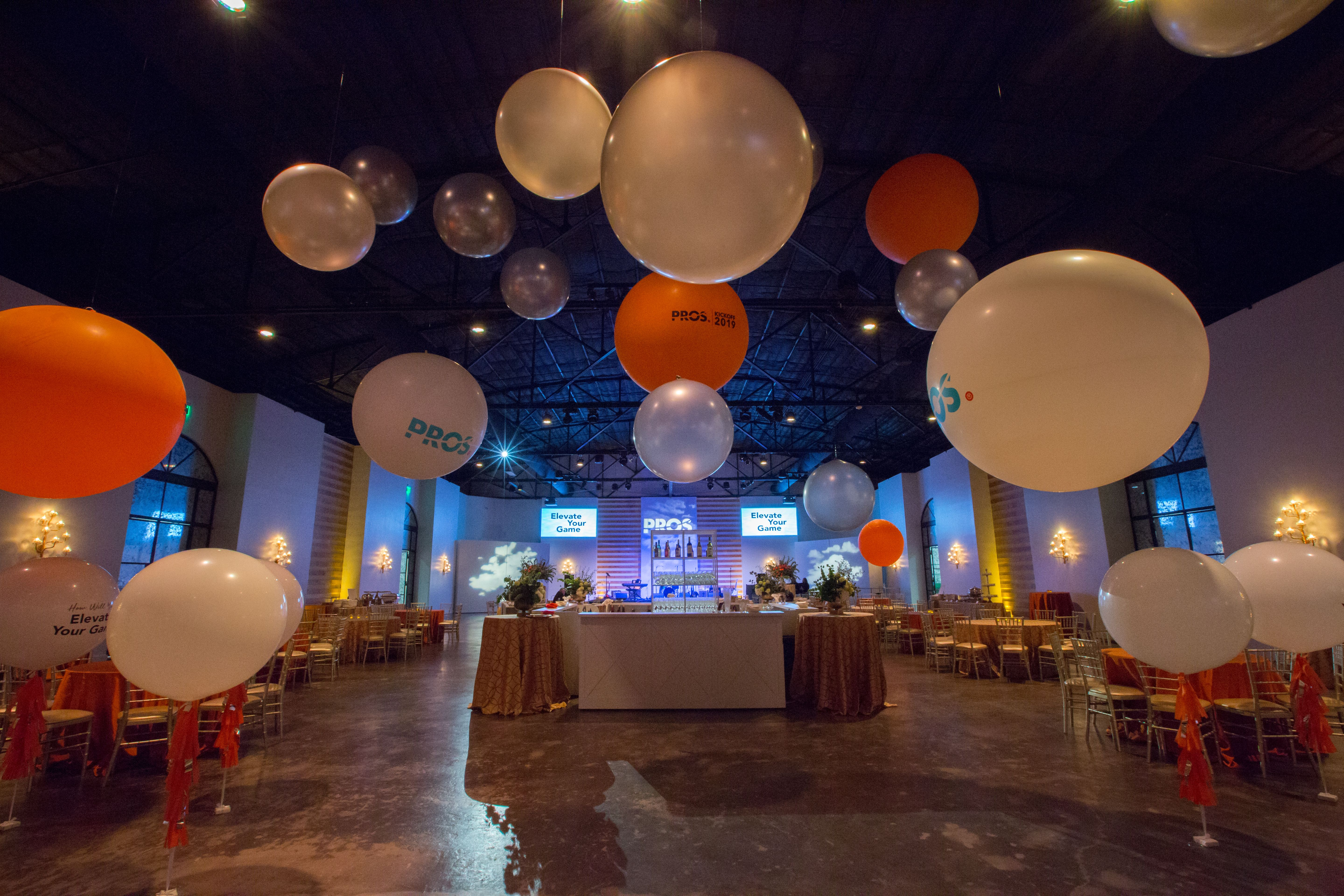Houston Venue The Revaire Balloons Event Design Yellow And Blue Lighting Seating Bar Highs Stage