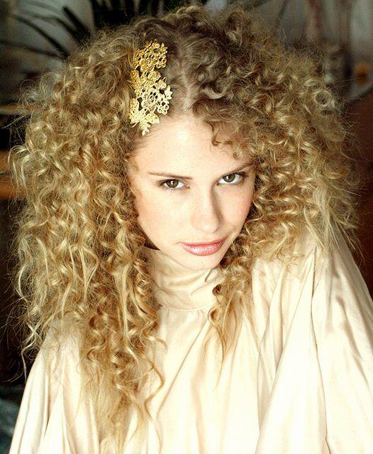 "Las Coronas ""Francesa"" hair brooch in cast plated gold."