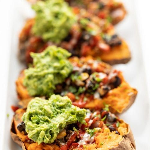 These Mexican Quinoa STUFFED Sweet Potatoes are the ultimate plant-based meal! Packed with fiber an
