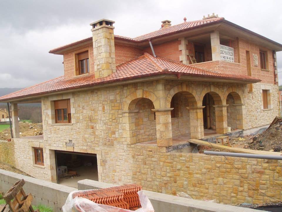 casa forrada con piedra