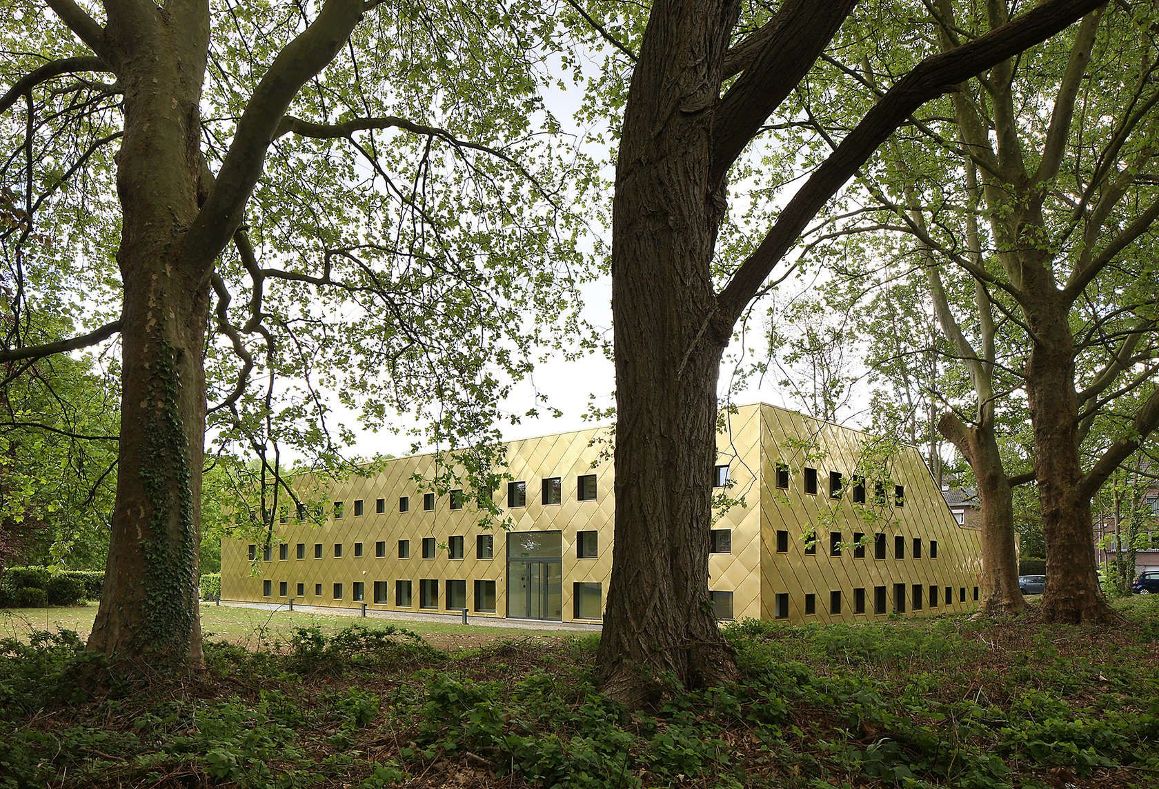 A Sustainable Library. The New Library In St Pieters Woluwe Is Conceived As  A Precious And Performative Object Amidst The Housing Fabric.