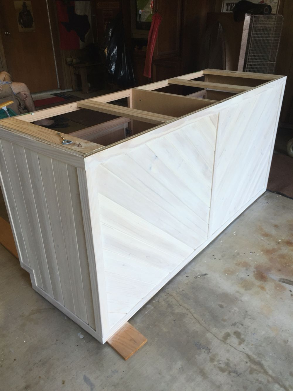 kitchen island made from 2 stock base cabinets wrapped with tongue