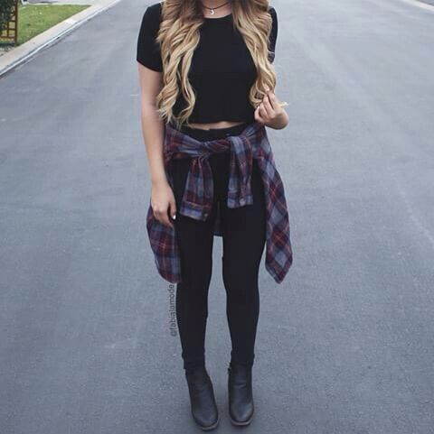 black tshirt crop top, black skinny pants, black ankle boots, and dark red and blue plaid collared button up shirt tied around the waist.