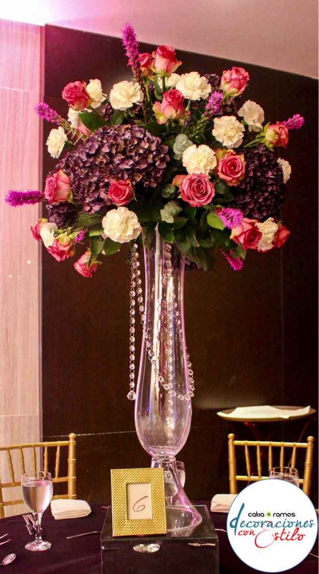 Purple hydrangea fucsia roses wedding centerpiece